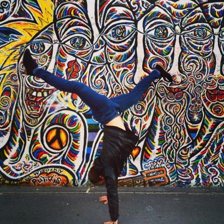 handstand in front of berlin wall